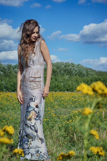 Beautiful Woman Beauty In Nature Hairstyle One Person Sky Flower Lifestyles Yellow Nature Young Women Hair Field Land Leisure Activity Standing Flowering Plant