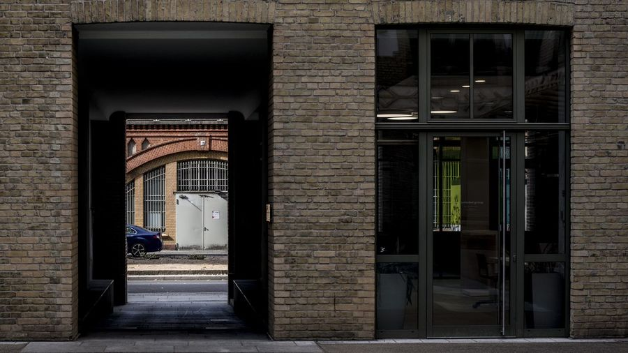 Marcweberde Arch Architecture Brick Brick Wall Building Building Exterior Built Structure City Closed Day Door Doorway Entrance Full Length One Person Open Outdoors Real People Window