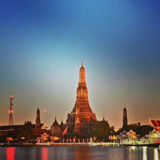 Wat Arun and the Chao Phraya River JKReyesPhotography Bangkok Thailand Watarun ChaoPhrayaRiver travel travelphotography backpackers backpacking landscape igers igdaily instagood igThailand scenery temple magichour snapseed SonyXperiaZ1 wanderlust Summer architecture structure tagsforlikes