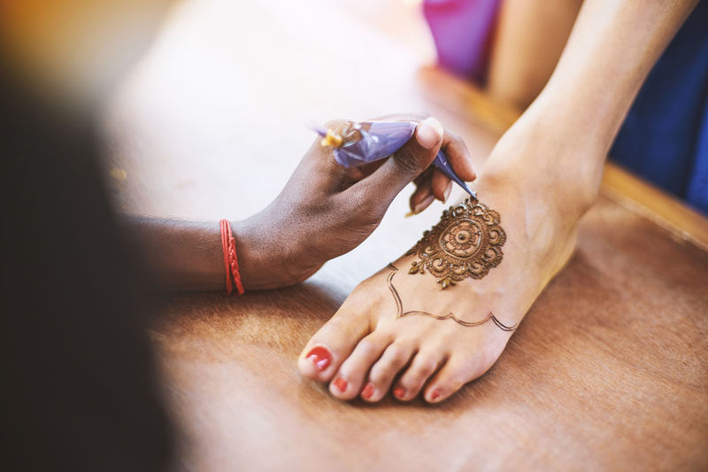 The Indian henna artist drawing the tattoo art (Mehndi) on the women foot on the indian wedding day Artist Celebration Foot Footpath India Indian Mehndi Tradition Wedding Art Beauty Celebrate Ceremony Concentrate Culture Drawing Ethnic Feet Henna Marriage  Painting Pooja Puja Sangeet Tattoo