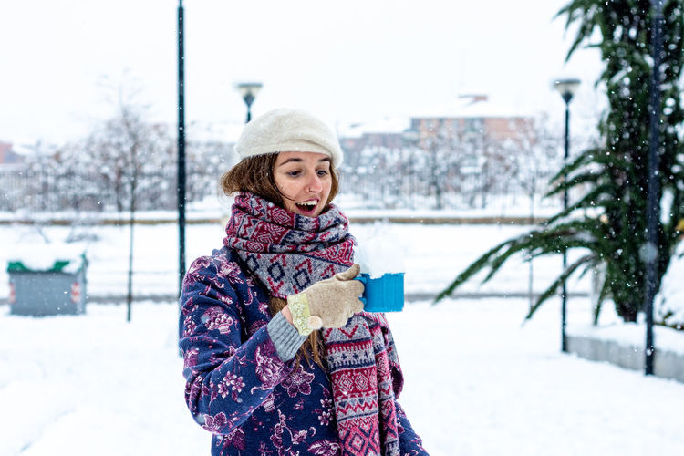Portrait of woman in park during winter