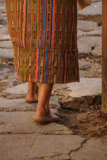 Low section of a woman standing barefeet