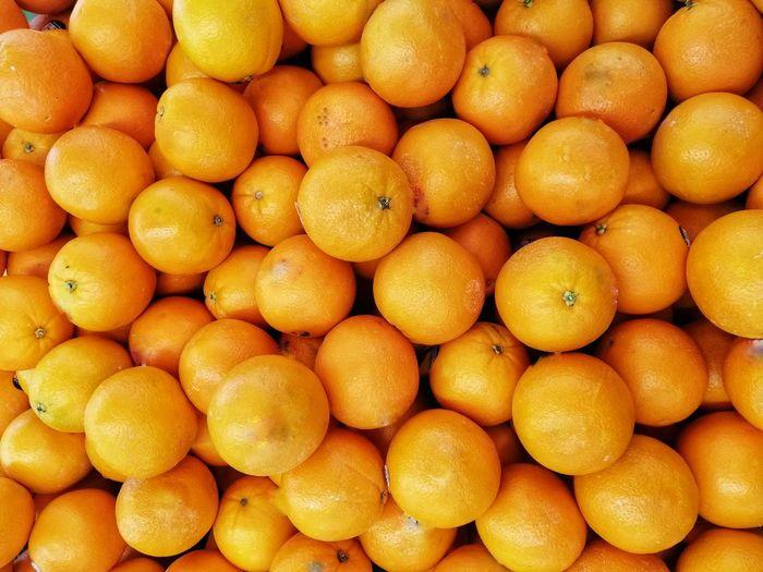 Full frame shot of oranges in market