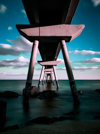 Sky Cloud - Sky Water Built Structure Sea Architecture Nature Land Horizon Over Water Scenics - Nature No People Horizon Beauty In Nature Beach Dusk Motion Tranquility Outdoors Tranquil Scene Pont Del Petroli Pont Del Petroli, Badalona, Spain Long Exposure Clouds Calm Place