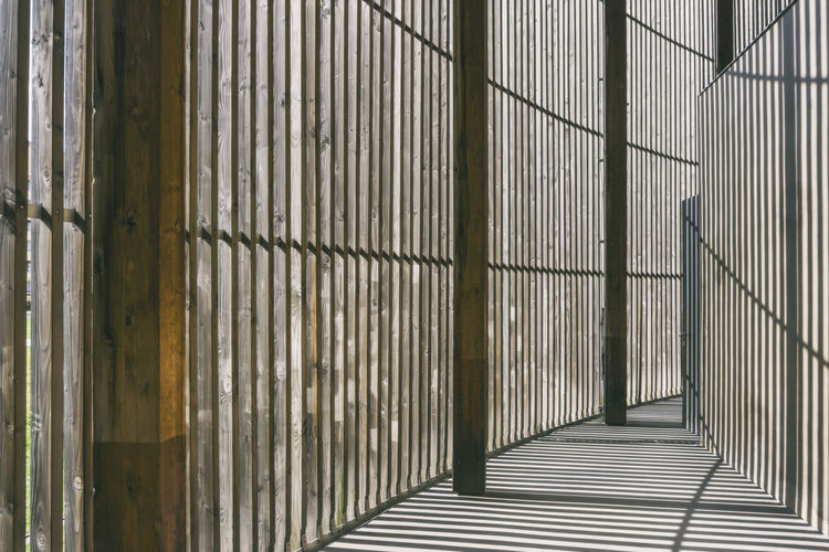 Wooden slat structure as part of the Chapel of Reconciliation at the Berlin Wall Memorial Park Berlin Berlin Wall Memorial Park Chapel Of Reconciliation Church Germany 🇩🇪 Deutschland Horizontal Shadows & Lights Color Image History Parallel Regularity Repetition Slats Structure Wooden