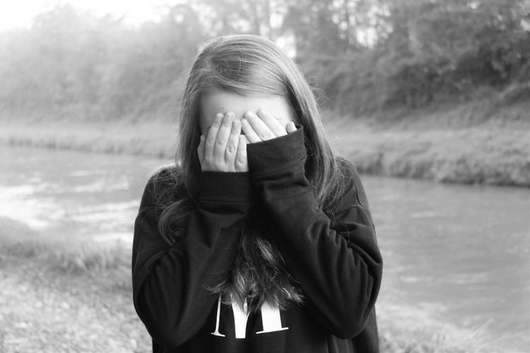 Young Adult Worried One Person Depression - Sadness Blackandwhite Young Women Real People Waist Up Front View Distraught  Uncomfortable Winter Women Cold Temperature Hands Covering Eyes Day Outdoors One Young Woman Only Portrait Nature