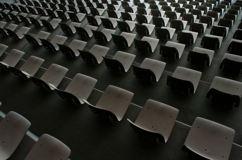 Rows of chairs in auditorium