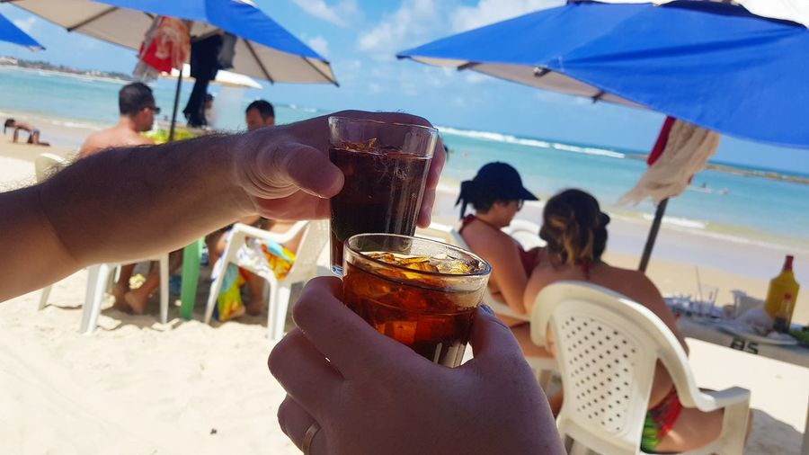 Group of people drinking glass on beach