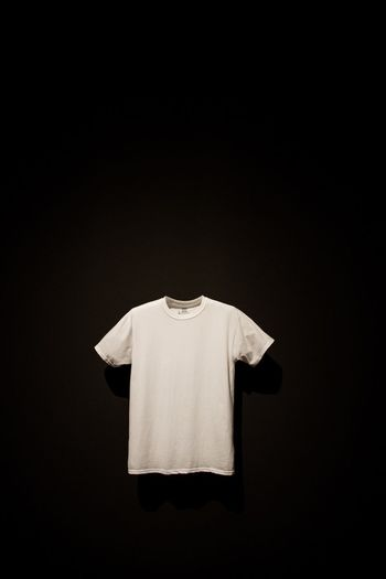 EyeEmNewHere Textile Copy Space Black Background No People Studio Shot Clothing Moma Museum Of Modern Art White Tshirt Abstract Conceptual