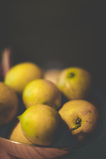 High Angle View Of Lemons In Container