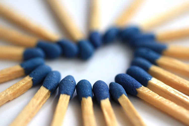 Close-up of matchsticks arranged in heart shape on table