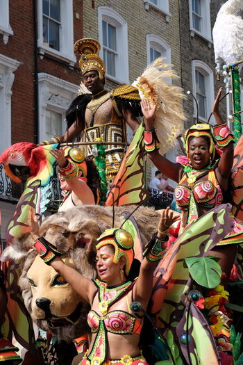 Dancers on Float, Paraiso School of Samba Composition Dancing Float GB London Man Paraiso School Of Samba Animal Representation Arms Raised Arts Culture And Entertainment Carnival Carnival Costumes Dancers Disguise Enjoyment Full Frame Fun Headresses Multi Colored Nottinghill Carnival 2017 Outdoor Photography Performance Tradition Two Women Uk