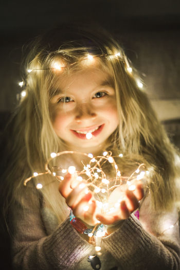 Front View Portrait Child Girls Females Smiling Childhood Looking At Camera One Person Happiness Illuminated Women Glowing Real People Blond Hair Hair Lifestyles Leisure Activity Hairstyle Innocence Sparkler Positive Emotion