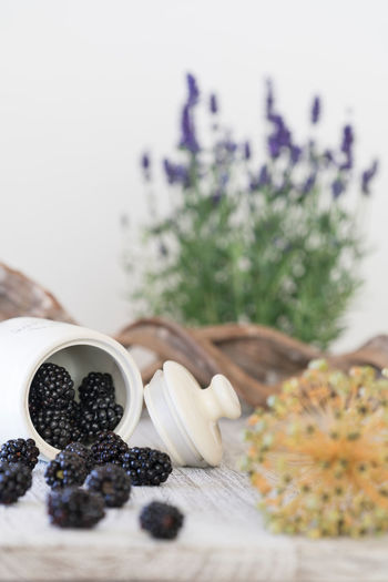 Blackberry Food And Drink Blackberry Blue Flowers Foodphotography Fresh Fruit Fruits Glass Healthy Eating Lavender No People Tabletop Woodmaterial
