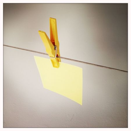 Adhesive Note Blank Clothes Line Clothes Pegs Clothes Pins Communication Conceptual Copy Space Data Empty Hanging Message Negative Space Note Papers Paper Post-it Post-It Note Reminder Single Object Symbol White Background Yellow