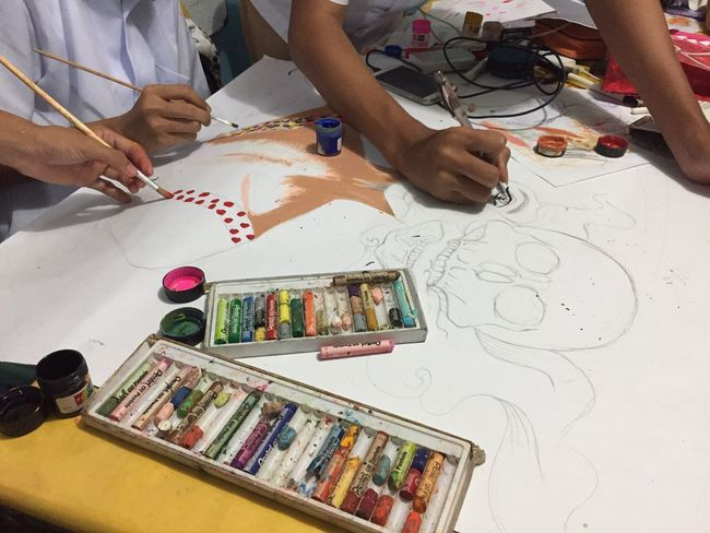 These guys are really busy with their project. Let's give them a like for a cool drawing! Creativity Art And Craft Table High Angle View Real People Paintbrush Artist Drawing - Activity Indoors  Human Body Part Skill  Paper Human Hand Palette Day People Close-up