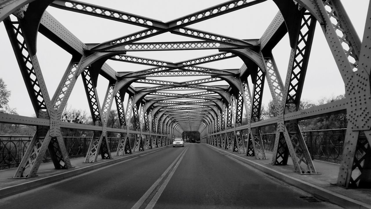 bridge - man made structure, connection, transportation, engineering, the way forward, diminishing perspective, architecture, built structure, metal, railroad bridge, road, day, bridge, outdoors, below, low angle view, sky, covered bridge, footbridge, underneath, no people