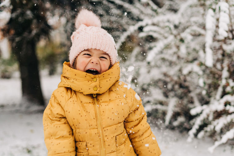 Portrait of smiling boy covered with snow