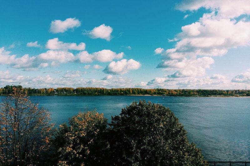 Scenic view of volga river against sky in autumn
