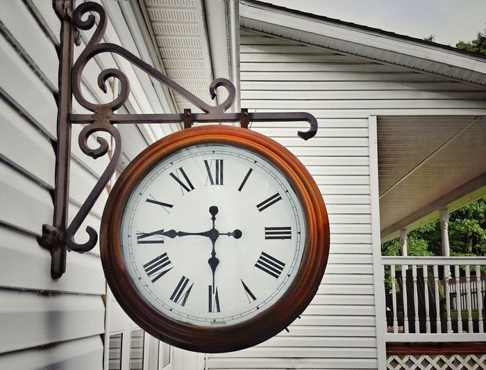 Low angle view of outdoor clock