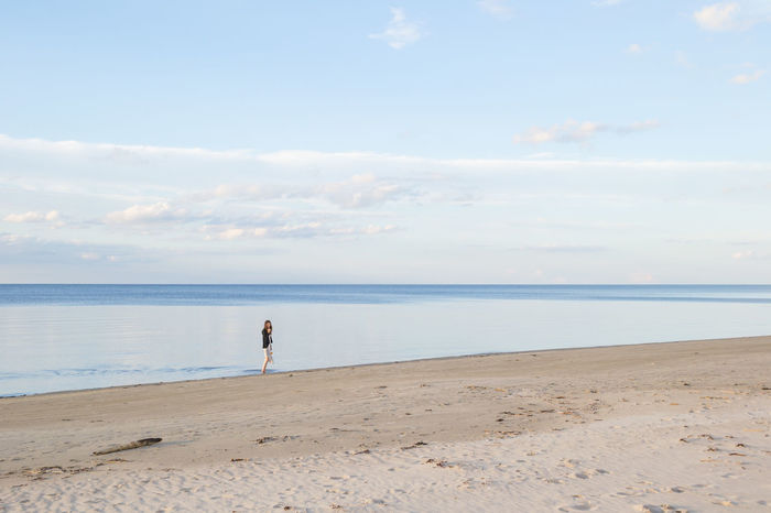 Beach Beauty In Nature Cloud Cloud - Sky Coastline Day Dress Horizon Over Water Idyllic Leisure Activity Lifestyles Nature Outdoors Remote Scenics Sea Shore Sky Stillness Tranquil Scene Tranquility Vacations Wading Water Woman