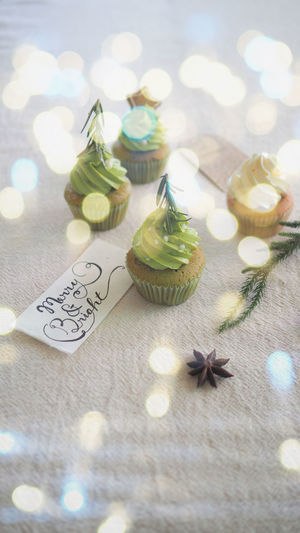 Cupcake and tag card decoration for celebrate christmas and happy new year background Christmas Cupcakes Christmas Decoration Christmas Theme Close-up Day Food Food And Drink Freshness High Angle View Indoors  Matchagreentea Mutcha No People Ready-to-eat Selective Focus Sweet Food Table Food Stories Shades Of Winter
