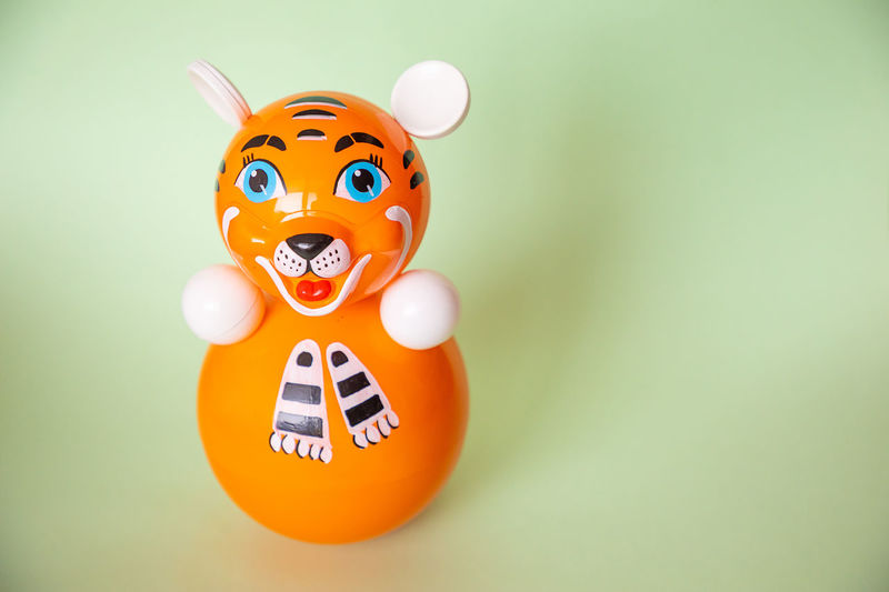Close-up of toys against orange background