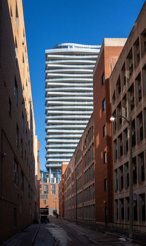 Toronto down town street capture Architecture Building Exterior Built Structure City Building Sky Clear Sky Street Low Angle View Day Outdoors Sunlight Direction Modern The Way Forward Urban Urban Geometry Toronto Down Town Blue Sky Residential District