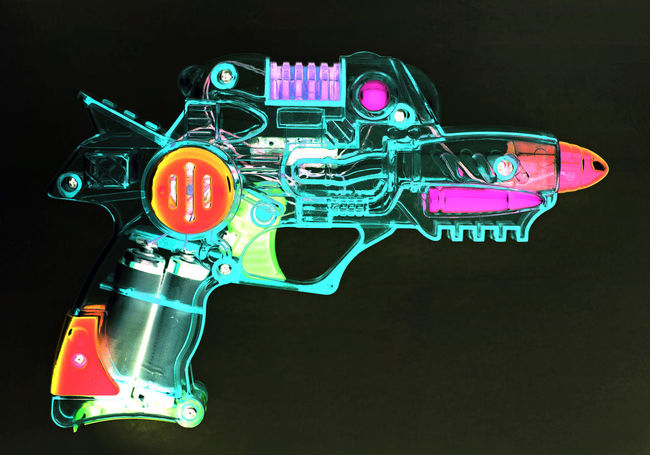 Gun Ray Gun Retro SiFi Black Background Close-up Creativity Details Glowing Illuminated Multi Colored Night No People Plastic Studio Shot Technology Toy Toy Gun Transparent