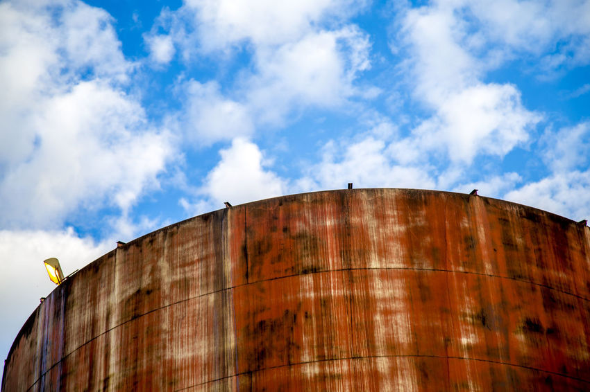 Destillery Alcohol Architecture Barrel Building Exterior Built Structure Cloud - Sky Container Cylinder Day Factory Industry Low Angle View Metal Nature No People Outdoors Rusty Sky Storage Compartment Storage Tank Sugar Cane Sunlight