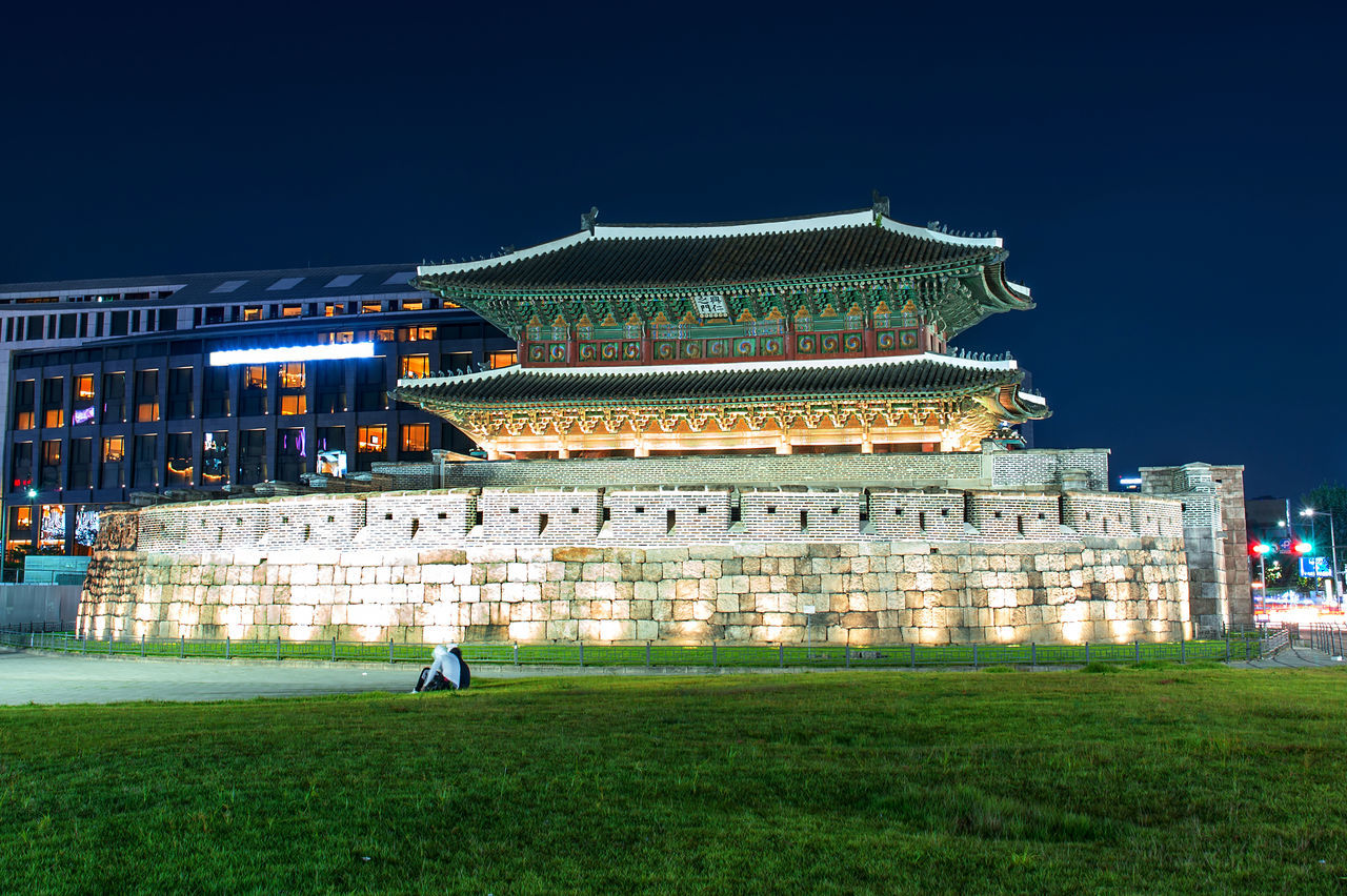 night, building exterior, architecture, built structure, illuminated, travel destinations, outdoors, grass, real people, sky, city