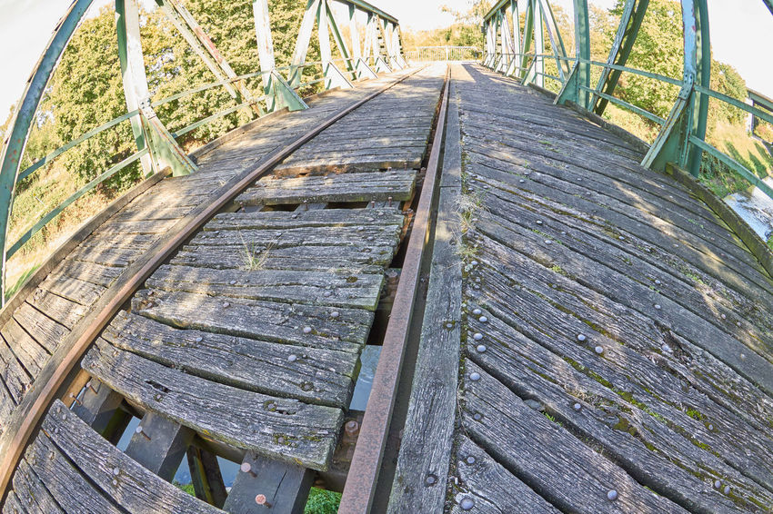 Railway Bridge Architecture Boardwalk Bridge Bridge - Man Made Structure Built Structure Connection Day Diminishing Perspective Direction Empty Footpath High Angle View Land Metal Nature No People Outdoors Railway Railway Bridge The Way Forward Track Transportation Wood - Material Wood Paneling