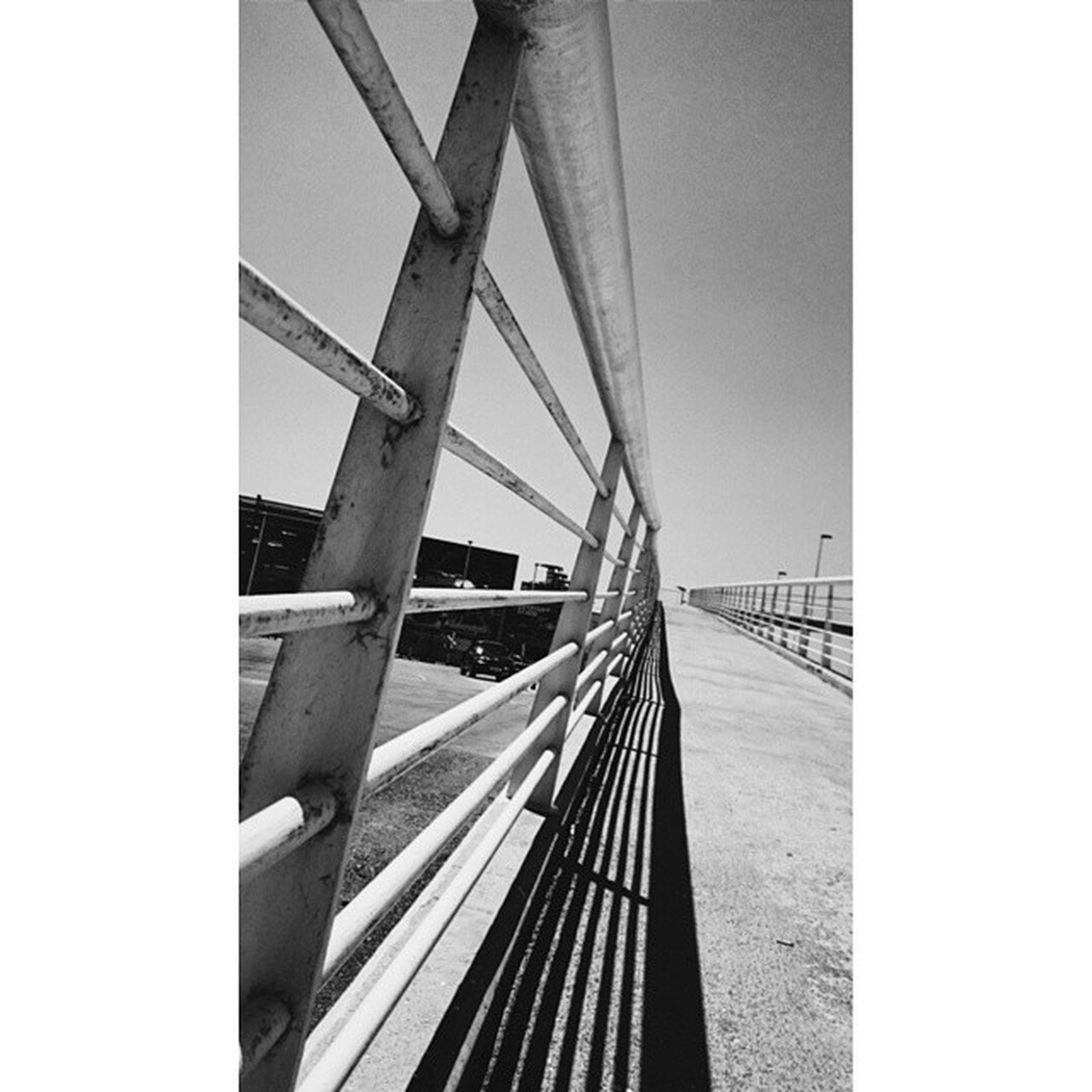 built structure, architecture, connection, bridge - man made structure, the way forward, transfer print, clear sky, railing, diminishing perspective, engineering, bridge, low angle view, auto post production filter, sky, transportation, footbridge, vanishing point, day, long, no people