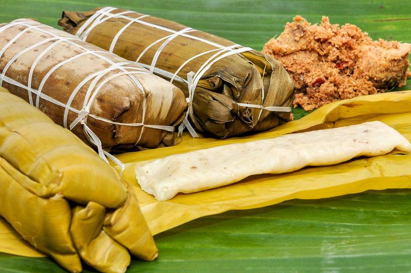 Burasak and nasu likku or steam rice in banana leaf with chicken galangal rendang.
