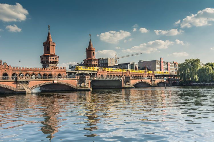 Low Angle View Of Oberbaum Bridge Over Spree River Against Sky
