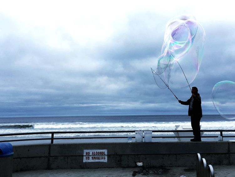 Sea Water Cloud - Sky Sky Full Length Nature One Person Standing Horizon Over Water Childhood Outdoors Beauty In Nature Day Big Bubble