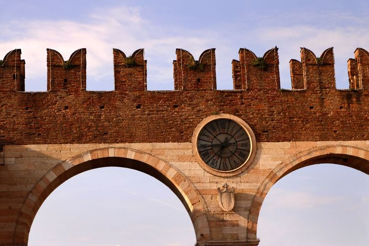 The Gateway to Piazza Bra ( I Portoni della Bra), part of the city walls of Verona, Italy Architecture Arch Sky Built Structure The Past History Low Angle View Building Exterior Travel Destinations No People Day Tourism Travel Cloud - Sky Ancient Old Outdoors Tower City Ancient Civilization Arched Arch Bridge Ruined Travel Photography Travel Destination