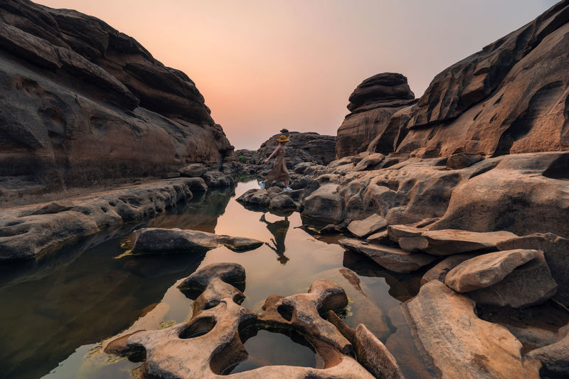 Scenic view of rock formations against sky during sunset
