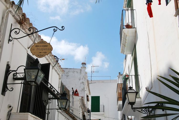 Street Dalt Vila EyeEm Selects City Sky Architecture Building Exterior Cloud - Sky Built Structure Street Art Clothesline Whitewashed Residential District Hanging Light Residential Structure Drying Human Settlement