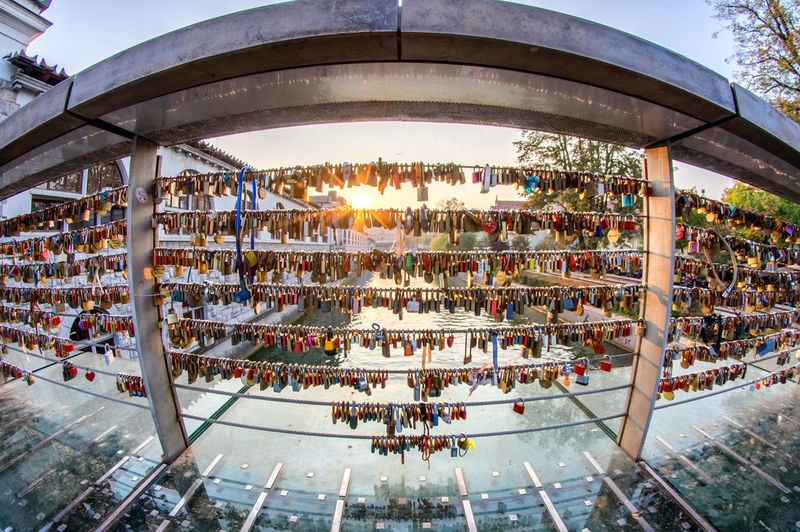 Locks on the bridge in Ljubljana Architecture Built Structure Nature Group Of People Crowd Outdoors Day Plant Building Exterior City Illuminated Women Lighting Equipment Glass - Material Travel Destinations Large Group Of People Variation Ljubljana Slovenia EyeEm City Shots Fisheye