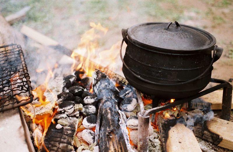 Wood burning stove on field