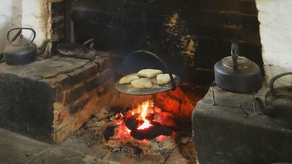 Homemade Fresh Bread Cooking in Fireplace . Homemade Bread Fireplace Kitchen Old Fashion Old Fashion Style Old Farm House Fire Cooking At Home Food Delicious Northern Ireland Interior Views Telling Stories Differently