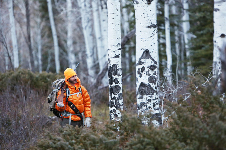 Person in snow covered forest