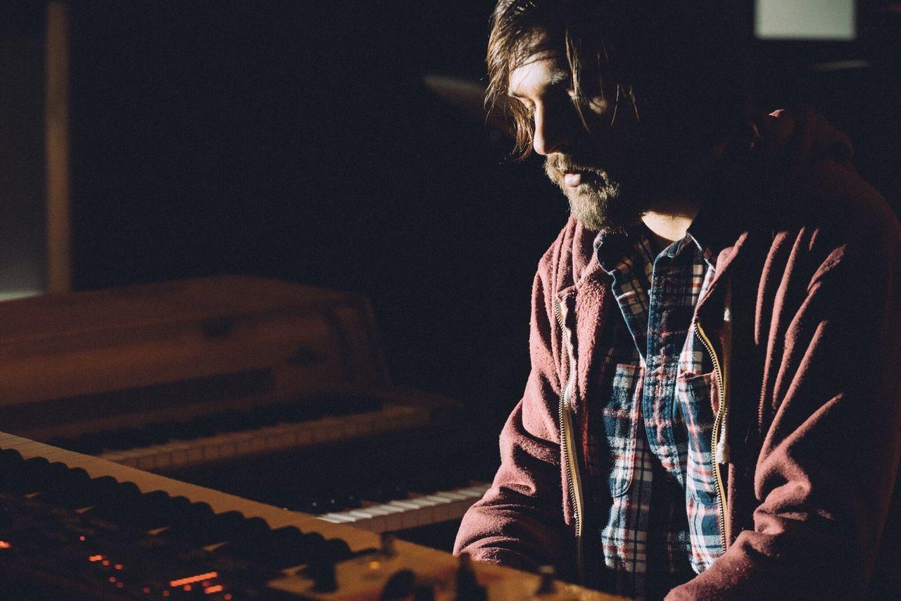 Close-up of man playing piano