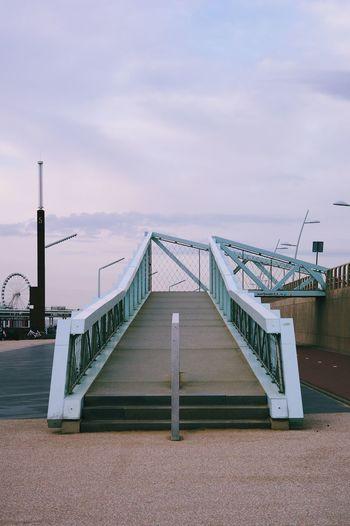 Empty pier over sea against sky