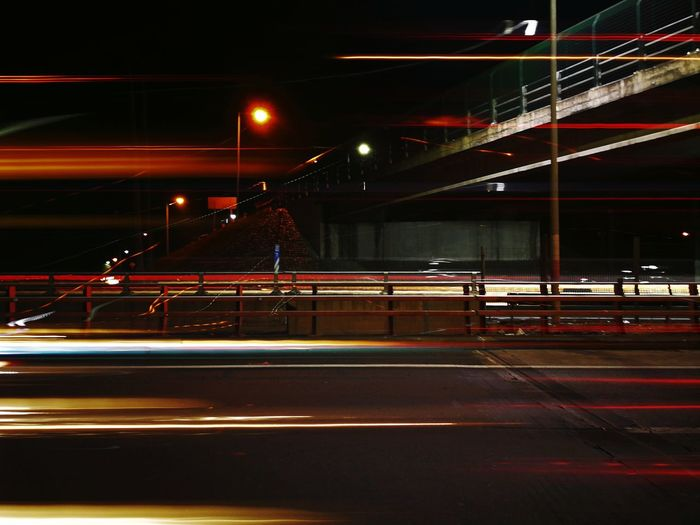 City Parking Garage Illuminated Road Sign Red Car Traffic Elevated Road Tail Light Multiple Lane Highway Vehicle Light Vehicle Red Light