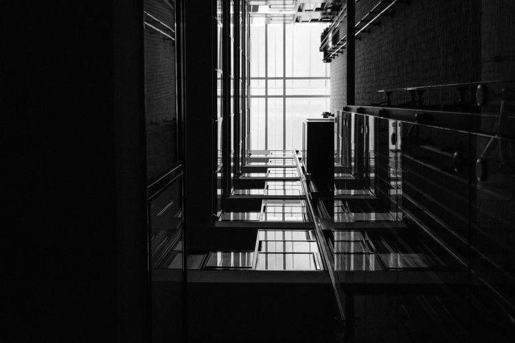Looking up Angle Architecture Art Barcelona Black & White Black And White Blackandwhite Built Structure Ceiling Day Elevator Elevators Indoors  Indoors  Looking Up No People Railing Sky SPAIN Square Staircase Steps And Staircases Up Weird Window