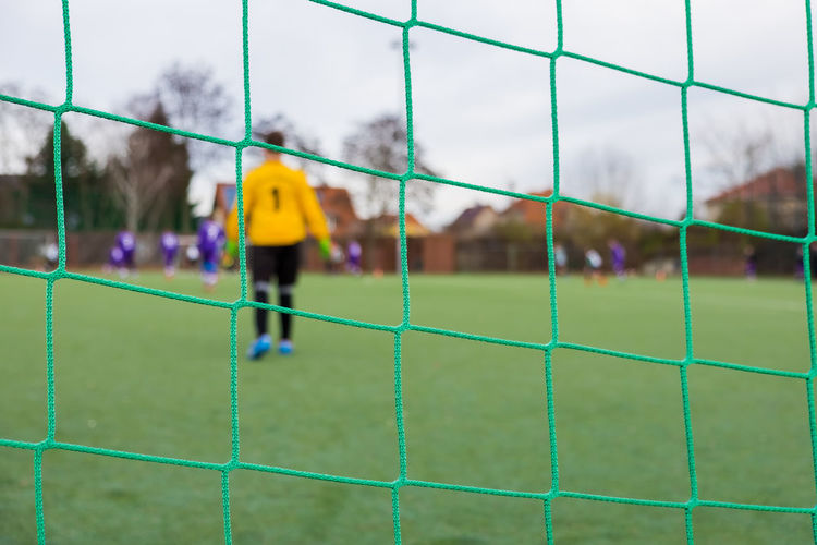 Close-up of green net on soccer field