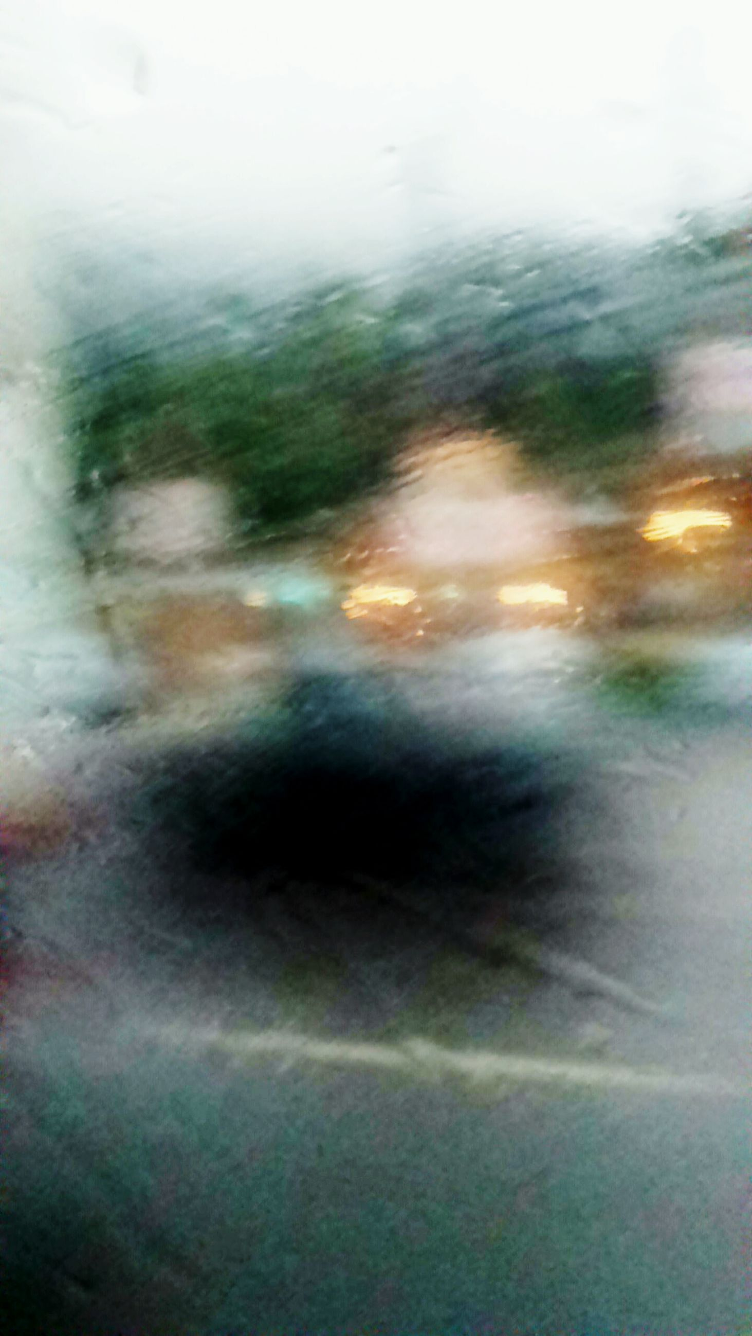 blurred motion, transportation, defocused, mode of transport, motion, road, travel, street, land vehicle, on the move, rain, window, water, blurred, city life, outdoors, blur, journey, multi colored, day