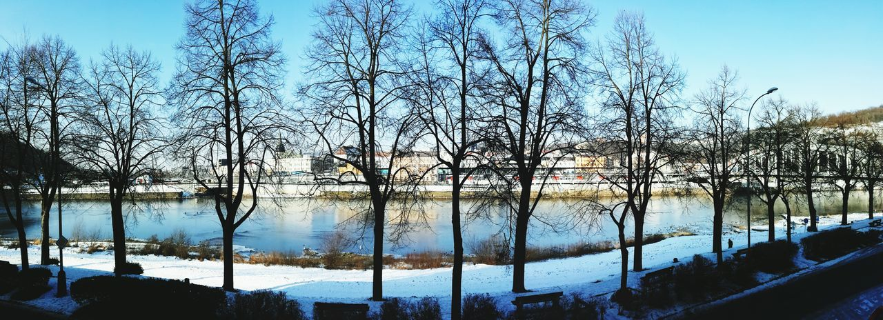 winter, cold temperature, snow, tree, bare tree, nature, beauty in nature, outdoors, reflection, day, no people, tranquility, frozen, lake, scenics, landscape, water, sky, architecture